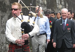 Piper Mal Turner leads the march to the memorial along the old Taipei Prison Wall