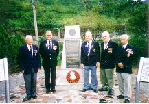Royal Navy crewmembers pay tribute to the POWs at the Kinkaseki Camp Memorial
